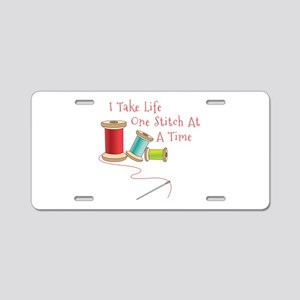 One Stitch at a Time Aluminum License Plate