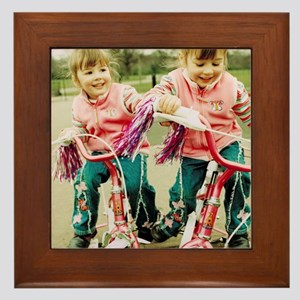 Identical twin girls Framed Tile