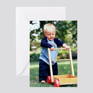 Young boy taking his first steps Greeting Card
