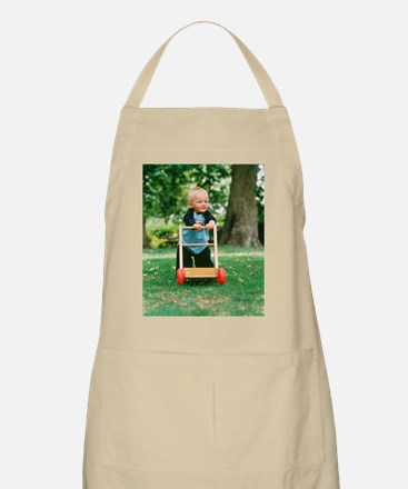 Young boy taking his first steps Apron