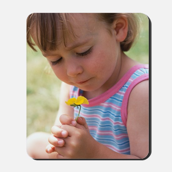 Young girl with a flower Mousepad