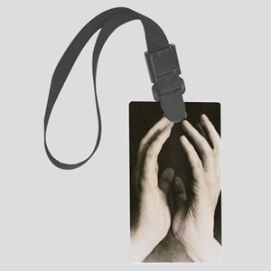 View of a woman's hands held tog Large Luggage Tag