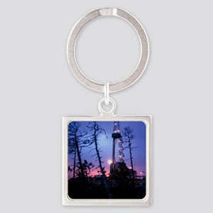 Derrick at an oil well in the even Square Keychain