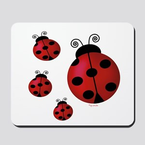Four ladybugs Mousepad