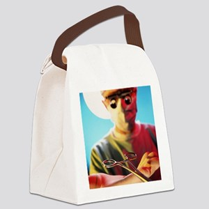 Surgeon carries out microsurgery Canvas Lunch Bag