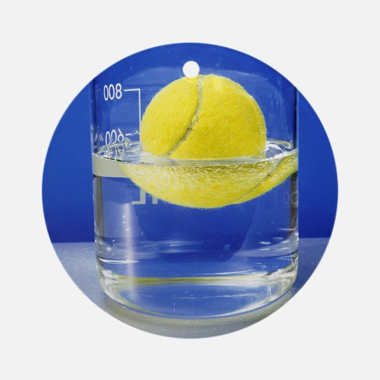 Tennis ball floating in water Round Ornament