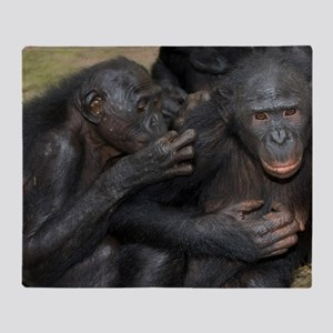Bonobo apes grooming Throw Blanket