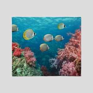 Butterflyfish over corals Throw Blanket