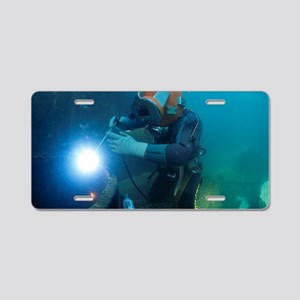Commercial diver welding Aluminum License Plate