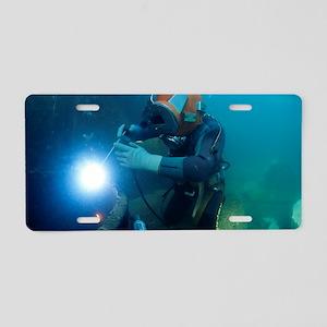 Commercial diver welding Aluminum License Plate