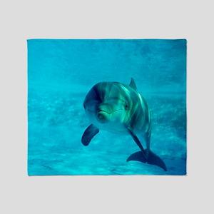 Dolphin in captivity Throw Blanket