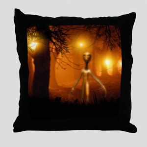 Alien emerging from a forest Throw Pillow