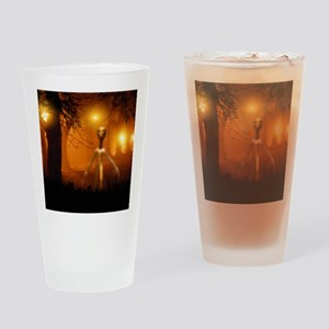Alien emerging from a forest Drinking Glass