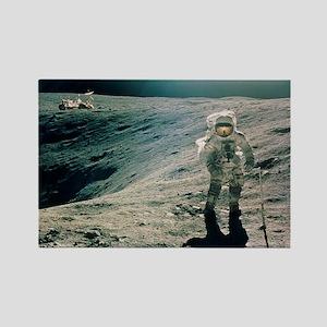 Astronaut Duke next to Plum Crate Rectangle Magnet
