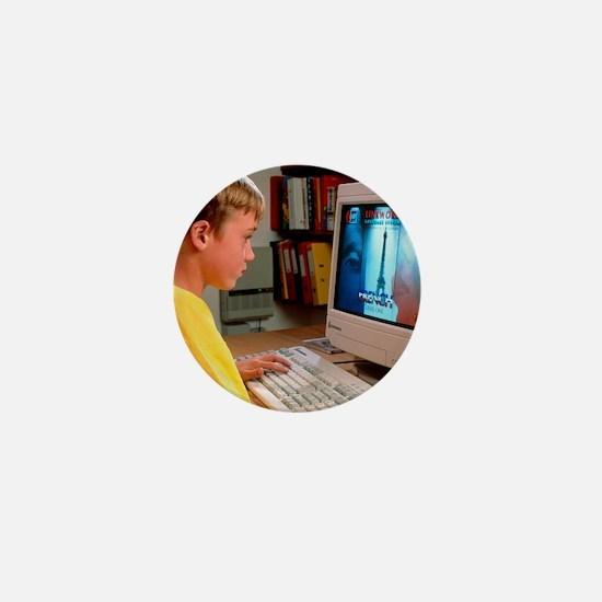 Boy using a multimedia computer to lea Mini Button