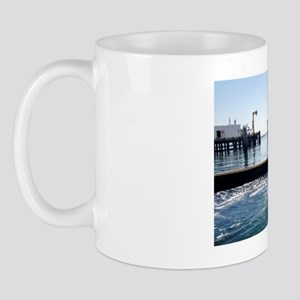 Bottlenose dolphin jumping out of water Mug