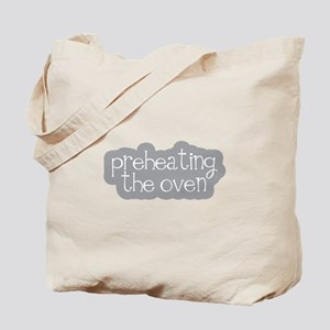 Preheating the Oven Tote Bag