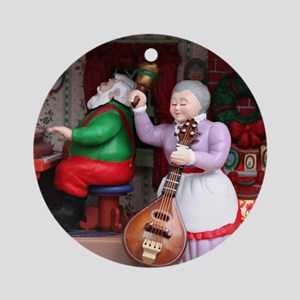Santa on Piana and Mrs. Claus with  Round Ornament