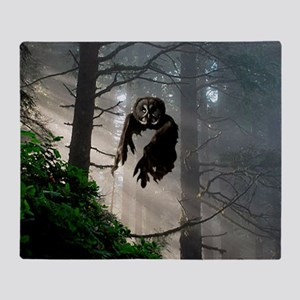 Owl flying out of forest Throw Blanket