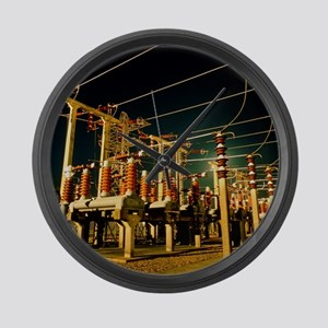 Electricity substation at night Large Wall Clock