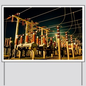 Electricity substation at night Yard Sign