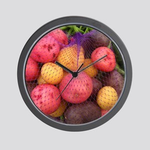 a bag of colorful potatoes among produc Wall Clock