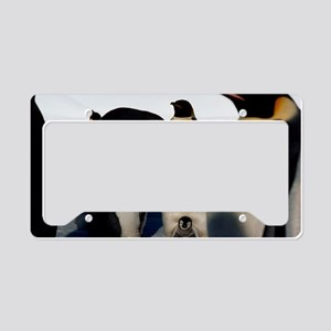 Emperor penguins sheltering c License Plate Holder
