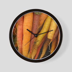 an assortment of long organic carrots i Wall Clock