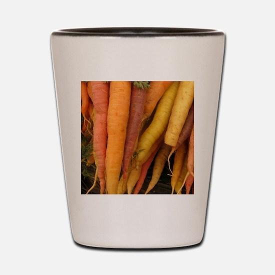 an assortment of long organic carrots i Shot Glass