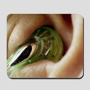 Earphone in an ear Mousepad