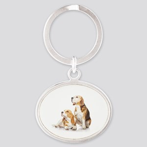 Two beagle dogs isolated on white ba Oval Keychain
