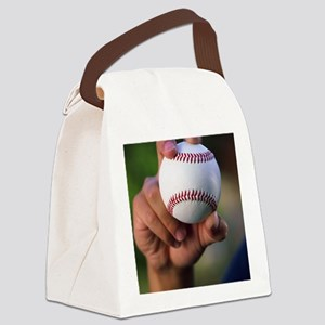 Hand holding baseball Canvas Lunch Bag
