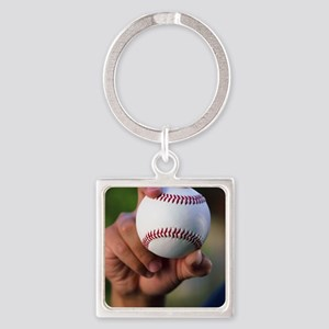 Hand holding baseball Square Keychain
