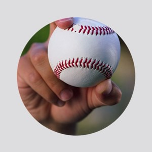 Hand holding baseball Round Ornament