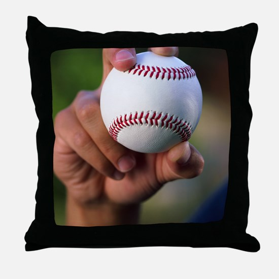 Hand holding baseball Throw Pillow