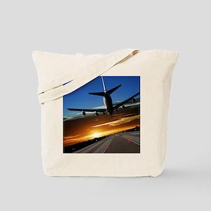 XL jumbo jet airplane landing at sunset Tote Bag