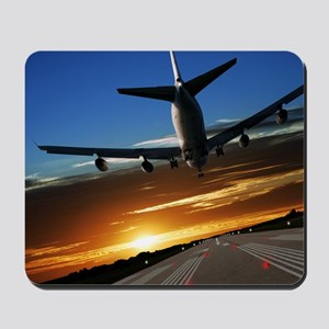 XL jumbo jet airplane landing at sunset Mousepad