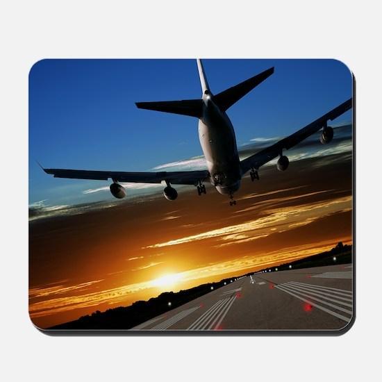 XL jumbo jet airplane landing at sunset Mousepad