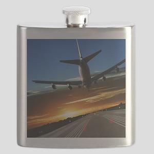XL jumbo jet airplane landing at sunset Flask