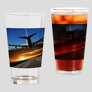 XL jumbo jet airplane landing at su Drinking Glass