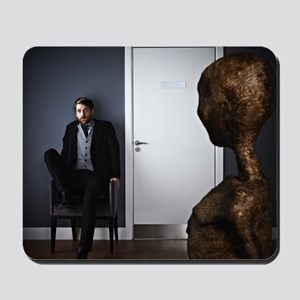 Extraterrestrial looking at scared man. Mousepad