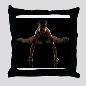 Studio shot of young woman practicing Throw Pillow