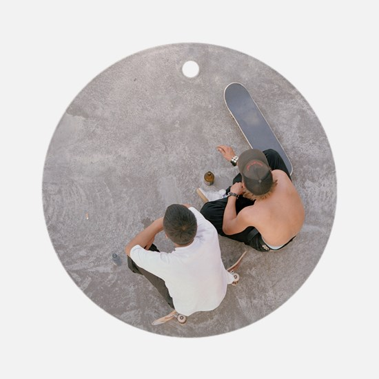 Two teenagers sat in skate park, ae Round Ornament