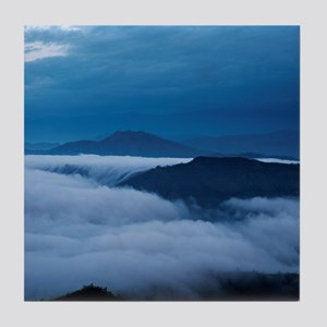View of mountains cloaked in fog and  Tile Coaster