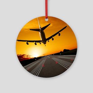 Jumbo jet airplane landing at sunse Round Ornament