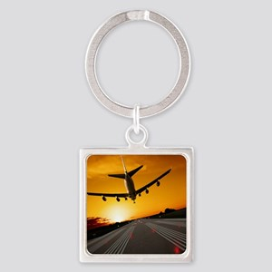 Jumbo jet airplane landing at suns Square Keychain