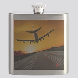 Jumbo jet airplane landing at sunset Flask