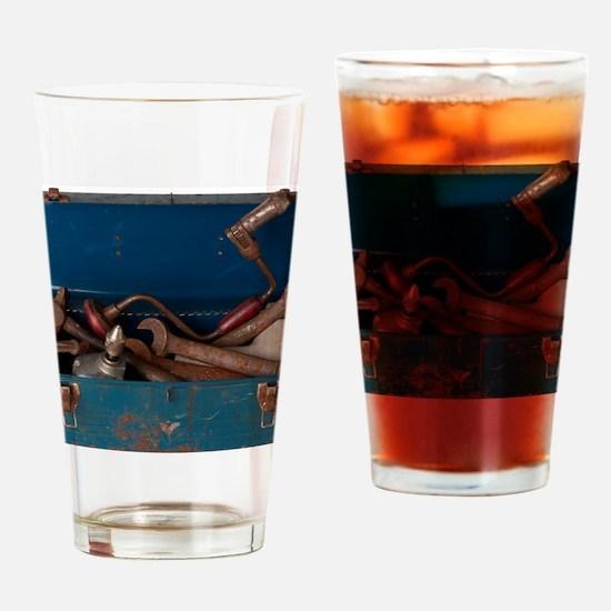 Rusty tool in blue metal box L1 Drinking Glass