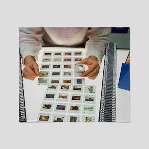 Photo editor choosing slide photogra Throw Blanket