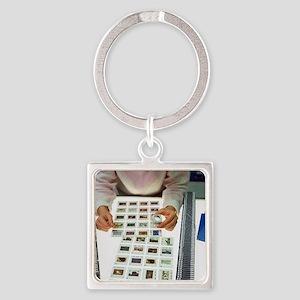 Photo editor choosing slide photog Square Keychain